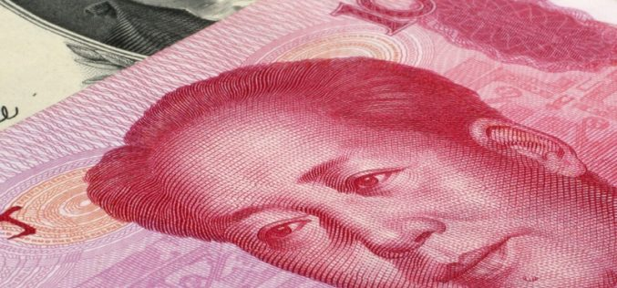 China lets the yuan drop to 7 against the dollar, its lowest in a decade